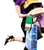 袋子运载的购物妇女 免版税库存图片