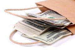 袋子货币 免版税图库摄影