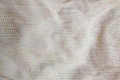 麻袋布在轻的乌贼属棕褐色米黄奶油色棕色颜色口气的被编织的纹理样式背景:Eco友好未加工有机 库存照片