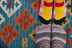 袜子和地毯 库存图片