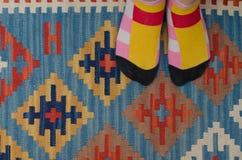 袜子和地毯 免版税图库摄影