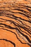 被上条纹的背景岩石 库存照片
