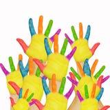 被举的许多被绘的儿童的手。 图库摄影
