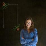 被交叉的妇女、学生或者老师双臂看您圣诞节霍莉菜单做清单 免版税库存照片