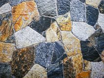 被仿造的瓦片地板仿造自然石头 库存图片