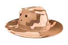 被伪装的徒步旅行队帽子 免版税库存照片