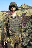 被伪装的战士 免版税库存照片