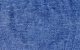 被佩带的牛仔布织品 免版税库存图片
