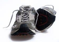 被佩带的老运动鞋培训人 库存图片