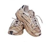 被佩带的老运动鞋 库存图片