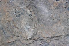 被佩带的背景室外板岩纹理 库存图片
