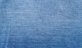 被佩带的蓝色牛仔布牛仔裤纹理 图库摄影