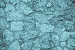 被修筑的自然石墙 免版税库存图片