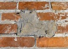 被修补的砖墙 库存图片