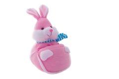 被充塞的软的桃红色兔子玩偶被隔绝在白色 免版税库存照片