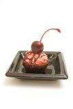 被冠上的果仁巧克力樱桃 库存照片