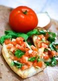 被冠上的bruschetta蕃茄 免版税库存照片