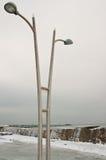被冰的路灯柱 免版税库存图片