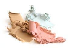 被击碎的接近的化妆用品  库存图片