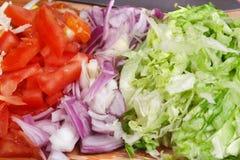 被分类的切成小方块的蔬菜 免版税图库摄影