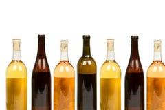 被分类的瓶五颜六色的酒 免版税图库摄影