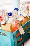被分类的新鲜的热带水果汁和牛奶 库存图片