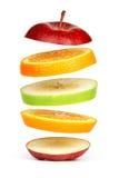 被切的新鲜水果浮动 库存图片