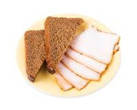 被切的猪肉猪油油脂用黑麦面包 图库摄影