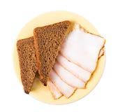 被切的猪肉猪油油脂用黑麦面包 库存照片