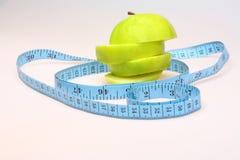 被切的苹果吃绿色健康 免版税图库摄影