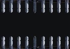 被删去的金属栏杆边界有黑色背景 免版税库存图片