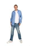 被剥去的牛仔裤男性设计 免版税库存照片