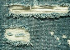 被剥去的牛仔裤的背景 免版税库存图片