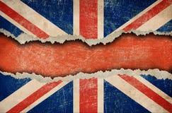 被剥去被撕毁的英国标志grunge纸张 免版税库存图片