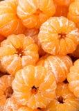 被剥皮的橙色柑桔蜜桔堆构造样式ba 库存照片