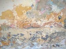 被剥皮的破裂的膏药墙壁背景 库存图片