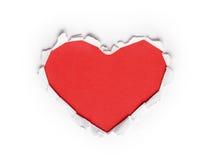 被剥去的心形的红色纸 免版税库存图片
