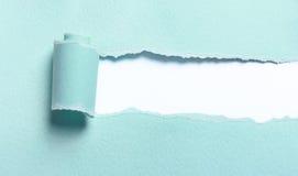 被剥去的浅兰的纸 免版税库存图片