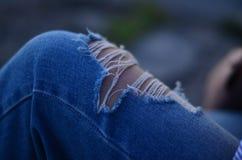 被剥去的牛仔裤 库存图片