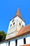 被加强的中世纪撒克逊人的教会在村庄Cincu, Grossschenk,特兰西瓦尼亚,罗马尼亚 图库摄影