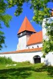 被加强的中世纪撒克逊人的教会在村庄Merghindeal- Mergenthal,特兰西瓦尼亚,罗马尼亚 免版税图库摄影