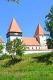 被加强的中世纪撒克逊人的教会在村庄Merghindeal- Mergenthal,特兰西瓦尼亚,罗马尼亚 免版税库存照片