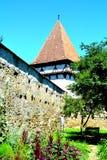 被加强的中世纪撒克逊人的教会在Cinsor-Kleinschenk,锡比乌县 免版税库存照片