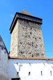 被加强的中世纪撒克逊人的教会的塔在村庄Malancrav,特兰西瓦尼亚 库存图片