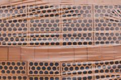 被包装的新建工程桔子砖 建筑材料 库存图片