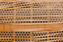 被包装的新建工程桔子砖 建筑材料 库存照片