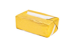 被包裹的黄油棍子在白色的 免版税图库摄影