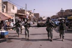 被卸下的军人巡逻警察 免版税库存图片