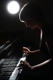 被启发的音乐家艺术照片 免版税库存图片