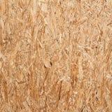 被回收的压缩木碎片墙壁 库存照片